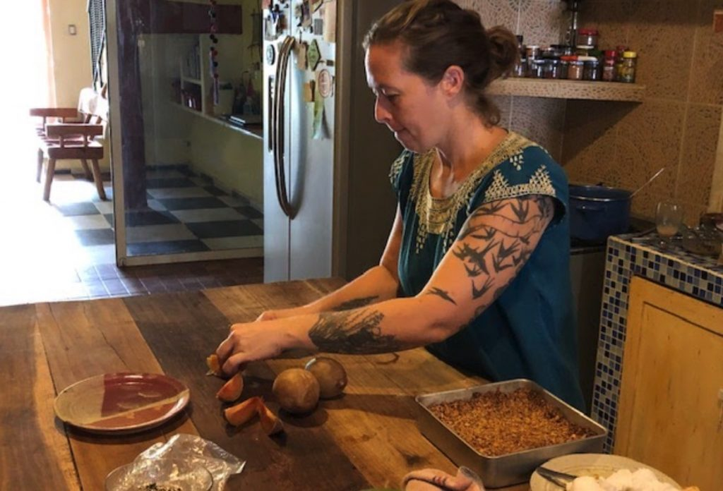 Young woman prepares food at counter
